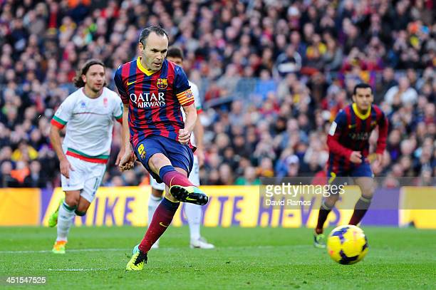 Andres Iniesta of FC Barcelona scores the opening goal from the penalty spot during the La Liga match between FC Barcelona and Granda CF at Camp Nou...