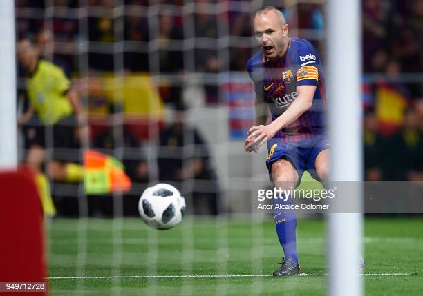 Andres Iniesta of FC Barcelona shoots for score the fourth goal during the Spanish Copa del Rey match between Barcelona and Sevilla at Wanda...