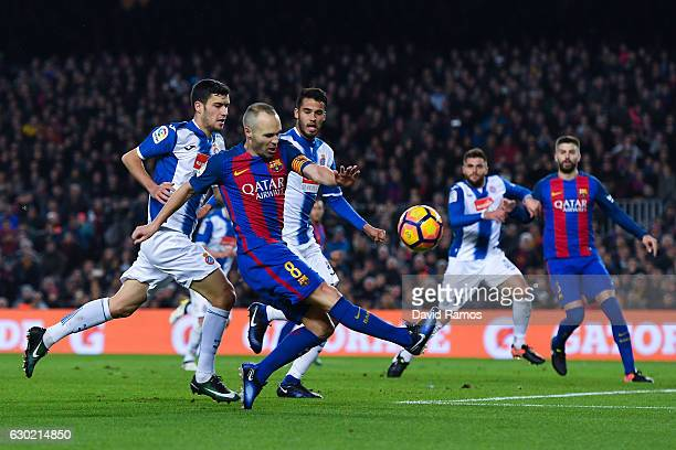 Andres Iniesta of FC Barcelona shoots towards goal during the La Liga match between FC Barcelona and RCD Espanyol at the Camp Nou stadium on December...