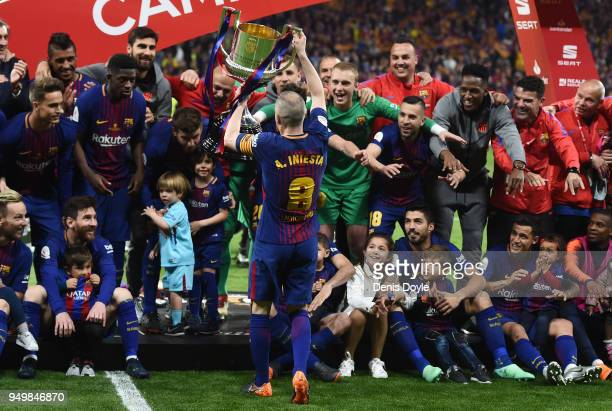 Andres Iniesta of FC Barcelona shows the trophy to teammates and their children after beating Sevilla 50 in the Spanish Copa del Rey Final match...