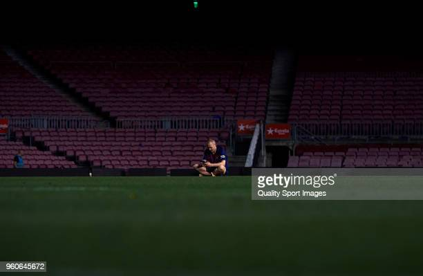 Andres Iniesta of FC Barcelona sits on the pitch at the end the La Liga match between Barcelona and Real Sociedad at Camp Nou on May 20 2018 in...