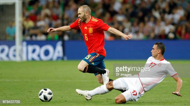 Andres Iniesta of Spain and Ellyes Skhiri of Tunisia battle for the ball during the friendly match between Spain and Tunisia at Krasnodar's stadium...