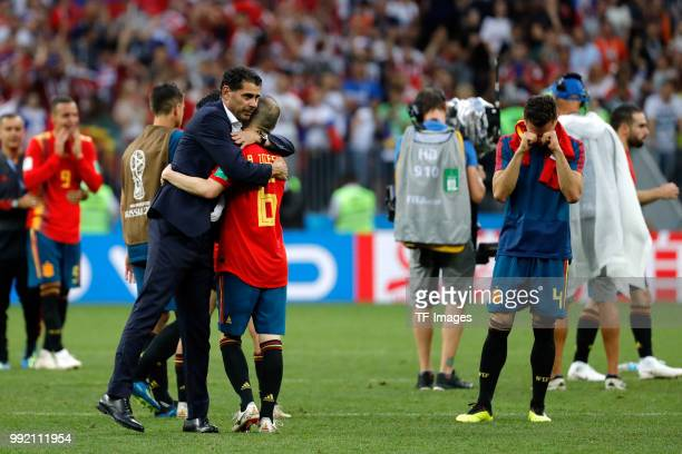 Andres Iniesta of Spain and Head coach Fernando Hierro of Spain look dejected after the 2018 FIFA World Cup Russia match between Spain and Russia at...