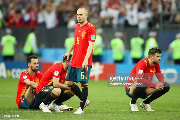 Andres Iniesta of Spain and his teammates look dejected after their team were eliminated during a penalty shootout during the 2018 FIFA World Cup...