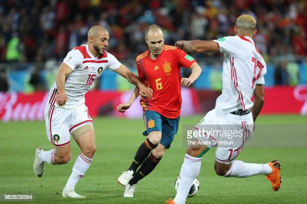 Andres Iniesta of Spain and Noureddine Amrabat of Morocco compete for the ball during the 2018 FIFA World Cup Russia group B match between Spain and...