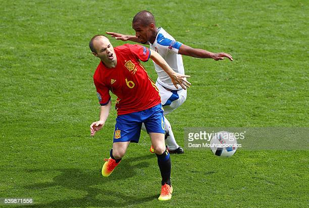 Andres Iniesta of Spain and Theodor Gebre Selassie of Czech Republic compete for the ball during the UEFA EURO 2016 Group D match between Spain and...