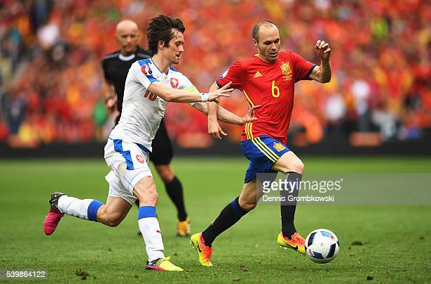 Andres Iniesta of Spain and Tomas Rosicky of Czech Republic compete for the ball during the UEFA EURO 2016 Group D match between Spain and Czech...
