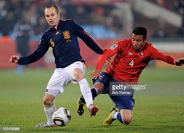 Andres Iniesta of Spain battles for the ball with Mauricio Isla of Chile during the 2010 FIFA World Cup South Africa Group H match between Chile and...