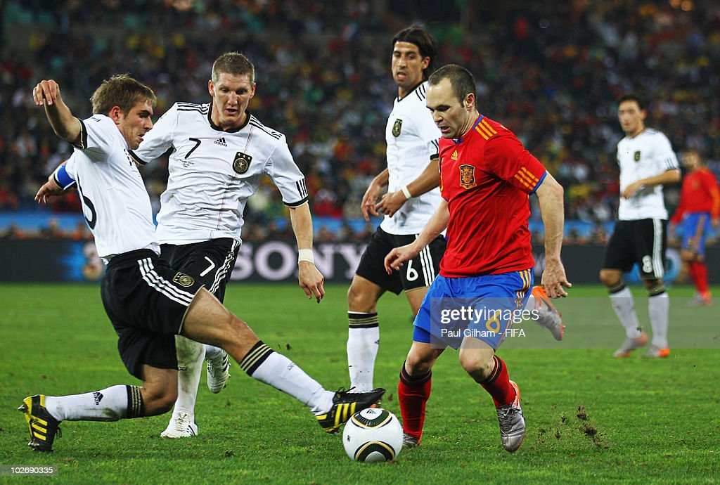 10133105 Andres Iniesta of Spain battles for the ball with Philipp Lahm of ...