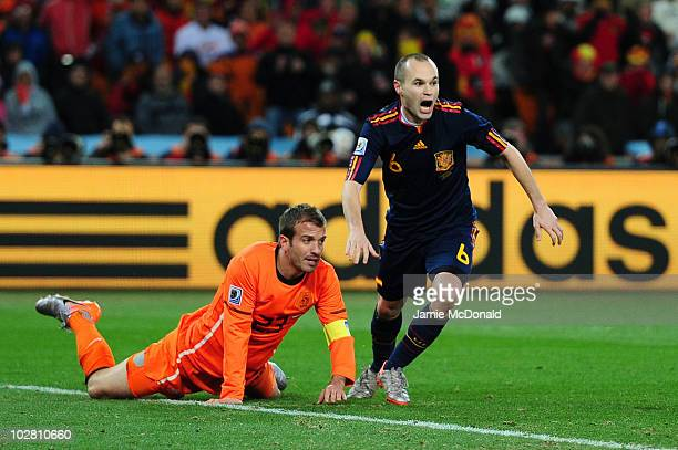 Andres Iniesta of Spain celebrates after scoring the winning goal as Rafael Van der Vaart of the Netherlands looks on during the 2010 FIFA World Cup...