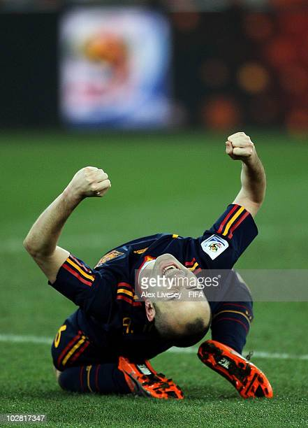 Andres Iniesta of Spain celebrates at the final whistle after the 2010 FIFA World Cup South Africa Final match between Netherlands and Spain at...