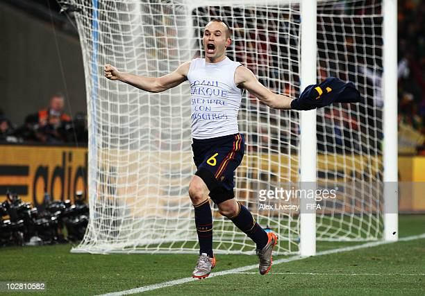 Andres Iniesta of Spain celebrates scoring during the 2010 FIFA World Cup South Africa Final match between Netherlands and Spain at Soccer City...