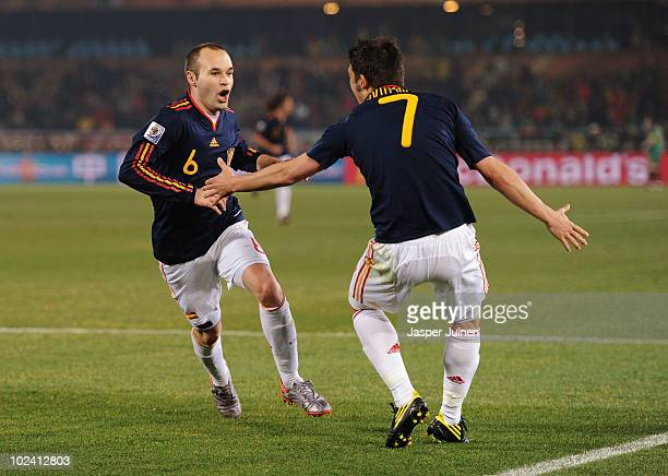 Andres Iniesta of Spain celebrates scoring the second goal for his team with David Villa during the 2010 FIFA World Cup South Africa Group H match...