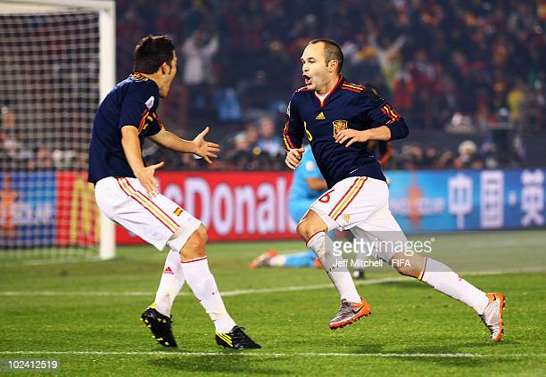Andres Iniesta of Spain celebrates scoring with David Villa during the 2010 FIFA World Cup South Africa Group H match between Chile and Spain at...