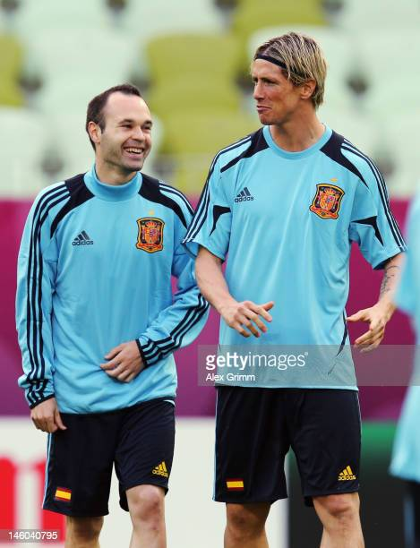 Andres Iniesta of Spain chats with Fernando Torres during a UEFA EURO 2012 training session ahead of their Group C match against Italy at the...