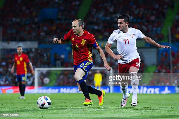 Andres Iniesta of Spain competes for the ball with Chanturia of Georgia during an international friendly match between Spain and Georgia at Alfonso...