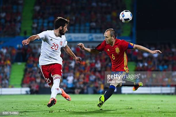 Andres Iniesta of Spain competes for the ball with Jigauri of Georgia during an international friendly match between Spain and Georgia at Alfonso...