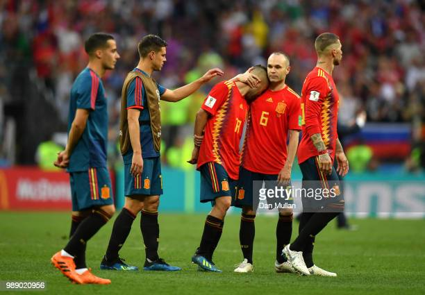 Andres Iniesta of Spain consoles teammate Jordi Alba of Spain following their sides defeat in the 2018 FIFA World Cup Russia Round of 16 match...