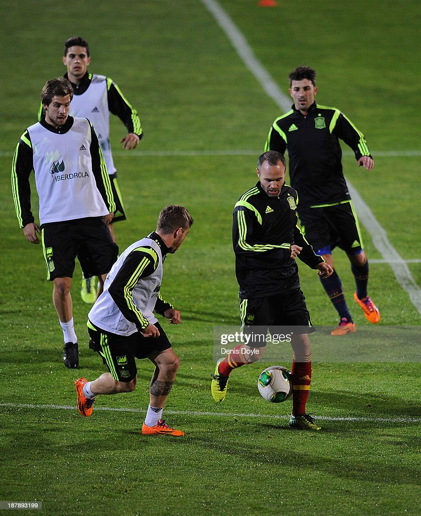 Andres Iniesta (front R) of Spain controls the ball during a training session ahead of their international friendly against Equatorial Guinea on November 13, 2013 in Las Rozas, Spain.