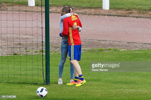 Andres Iniesta of Spain embraces his wife Anna Ortiz after a training session at Complexe Sportif Marcel Gaillard on June 19 2016 in La Rochelle...