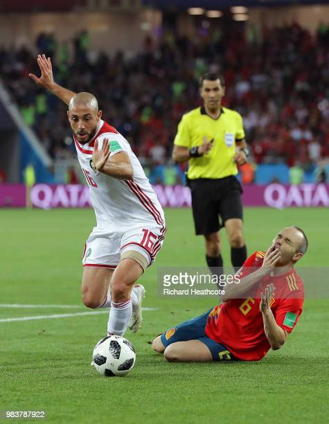 Andres Iniesta of Spain goes to ground after a challenge from Noureddine Amrabat of Morocco during the 2018 FIFA World Cup Russia group B match...