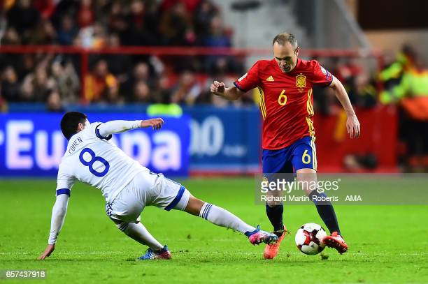 Andres Iniesta of Spain is challenged by Almog Cohen of Israel during the FIFA 2018 World Cup Qualifier between Spain and Israel at Estadio El...