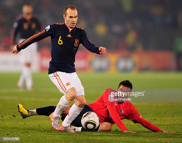 Andres Iniesta of Spain is challenged by Mauricio Isla of Chile during the 2010 FIFA World Cup South Africa Group H match between Chile and Spain at...