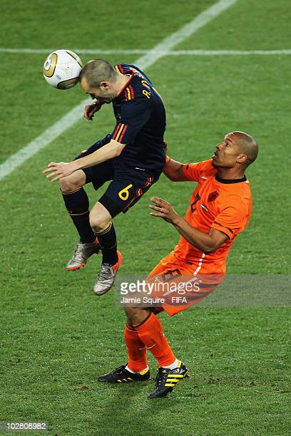 Andres Iniesta of Spain is challenged by Nigel De Jong of the Netherlands during the 2010 FIFA World Cup South Africa Final match between Netherlands...