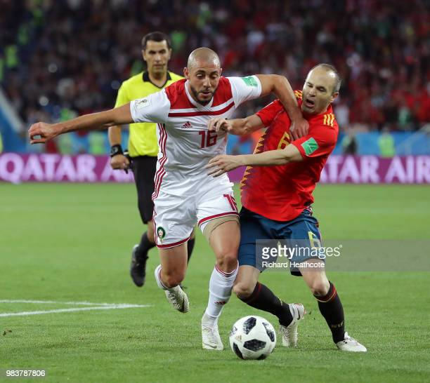 Andres Iniesta of Spain is challenged by Noureddine Amrabat of Morocco during the 2018 FIFA World Cup Russia group B match between Spain and Morocco...