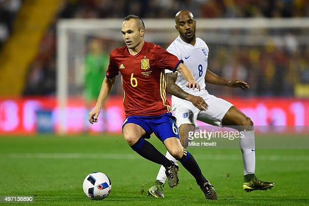 Andres Iniesta of Spain is chased by Fabian Delph of England during an International Friendly between Spain and England at the Estadio José Rico...