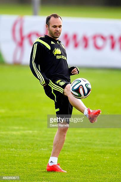 Andres Iniesta of Spain juggles the ball during a Spain training session at the Centro de Entrenamiento do Caju on June 9 2014 in Curitiba Brazil