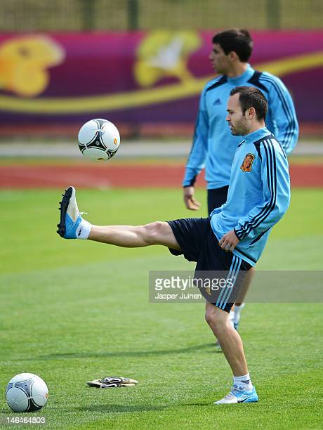 Andres Iniesta of Spain juggles the ball during a training session ahead of their UEFA EURO 2012 group C match against Croatia on June 17 2012 in...