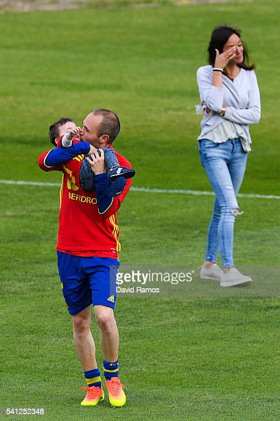 Andres Iniesta of Spain kisses his son Paolo Andrea as his wife Anna Ortiz reacts on the background after a training session at Complexe Sportif...