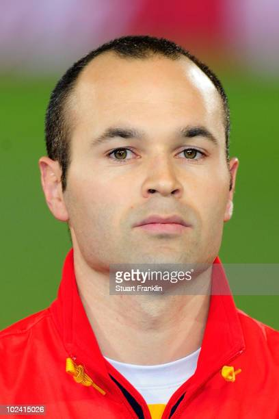 Andres Iniesta of Spain lines up for the national anthems prior to the 2010 FIFA World Cup South Africa Group H match between Chile and Spain at...