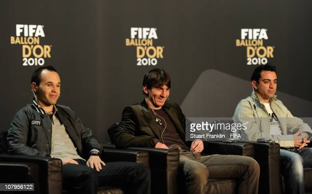 Andres Iniesta of Spain, Lionel Messi of Argentina and Xavi of Spain during a press conference prior to the FIFA Ballon d'Or Gala 2010 t the congress...