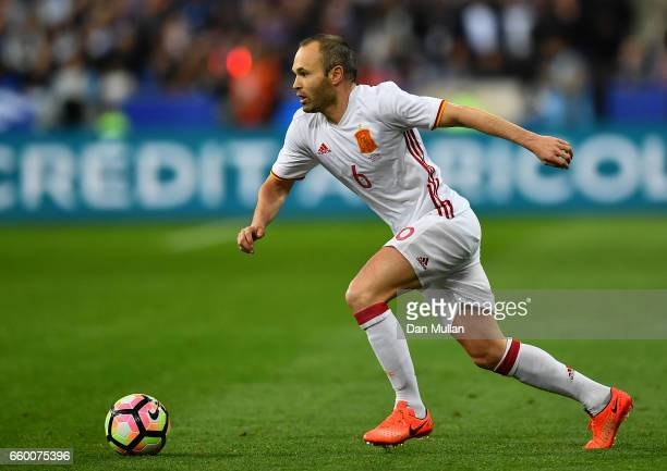 Andres Iniesta of Spain looks for space during the International Friendly match between France and Spain at the Stade de France on March 28 2017 in...