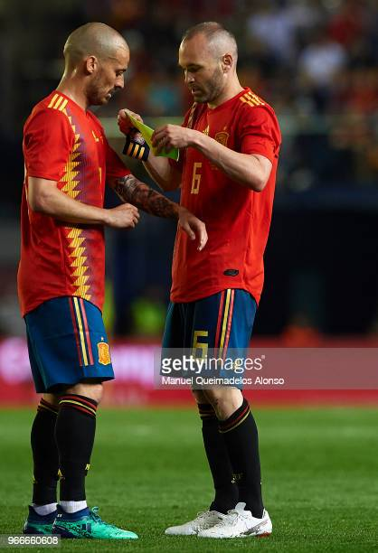 Andres Iniesta of Spain passes the Captain's armband to David Silva during the International Friendly match between Spain and Switzerland at Estadio...