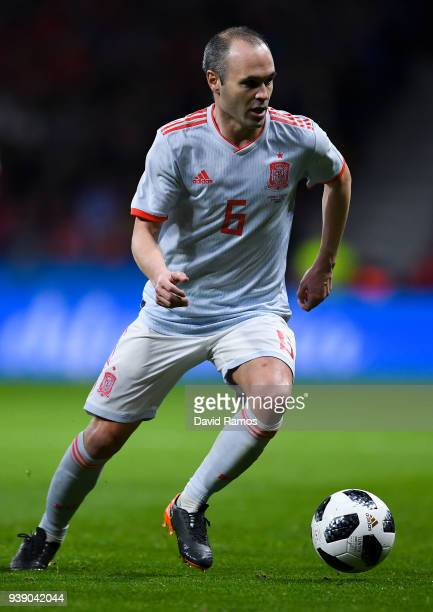 Andres Iniesta of Spain runs with the ball during an International friendly match between Spain and Argentina at the Wanda Metropolitano stadium on...