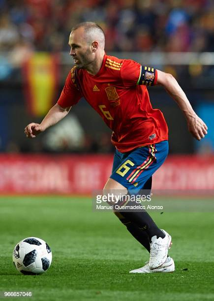 Andres Iniesta of Spain runs with the ball during the International Friendly match between Spain and Switzerland at Estadio de La Ceramica on June 3...