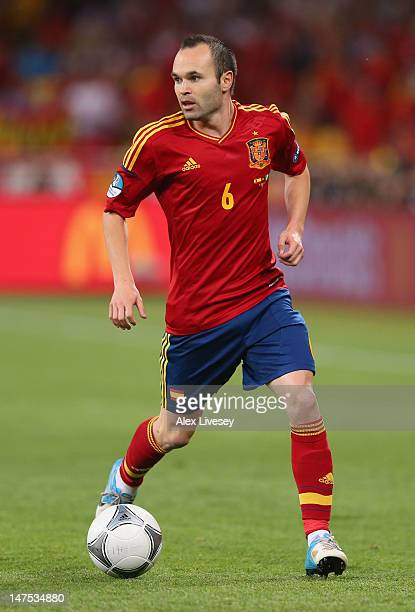 Andres Iniesta of Spain runs with the ball during the UEFA EURO 2012 final match between Spain and Italy at the Olympic Stadium on July 1 2012 in...