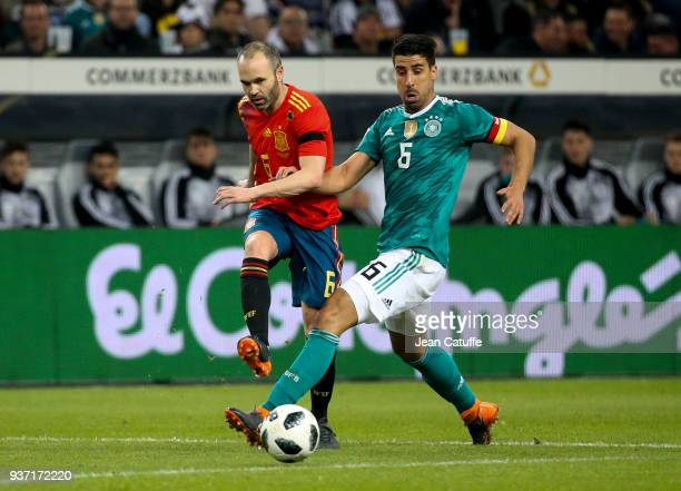 Andres Iniesta of Spain Sami Khedira of Germany during the international friendly match between Germany and Spain at EspritArena on March 23 2018 in...