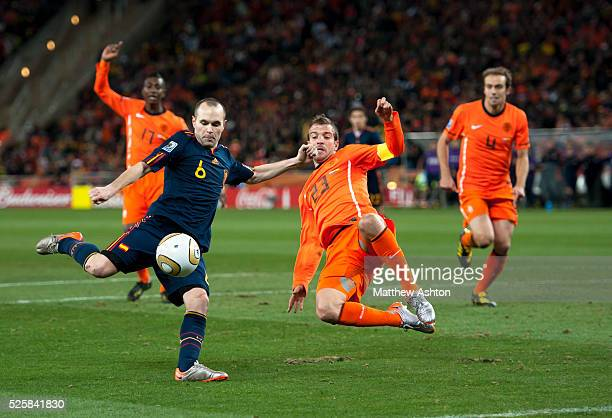 Andres Iniesta of Spain scores a goal to make it 01
