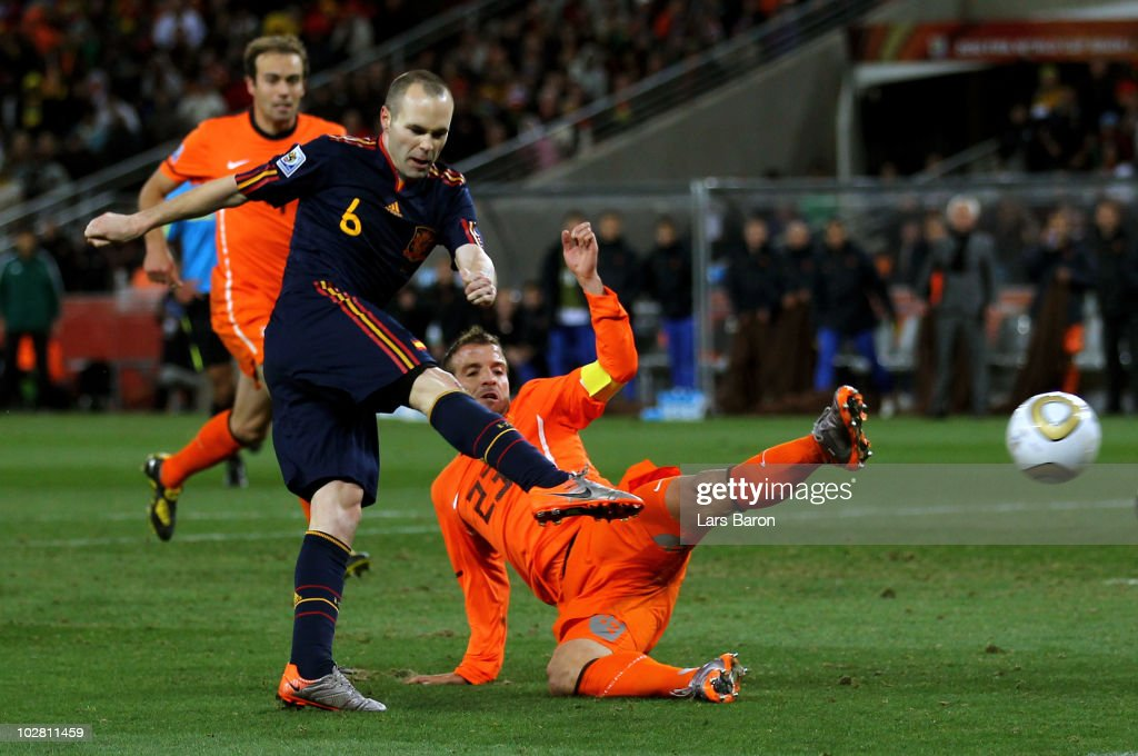 Andres Iniesta of Spain scores his side's first goal during the 2010 FIFA World Cup South Africa Final match between Netherlands and Spain at Soccer City Stadium on July 11, 2010 in Johannesburg, South Africa.