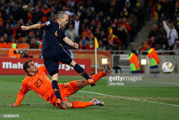 Andres Iniesta of Spain scores the winning goal as Rafael Van der Vaart of the Netherlands tries to block the shot during the 2010 FIFA World Cup...