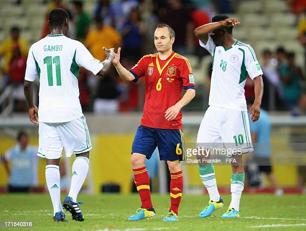 Andres Iniesta of Spain shakes hands with Mohammed Gambo of Nigeria after the FIFA Confederations Cup Brazil 2013 Group B match between Nigeria and...