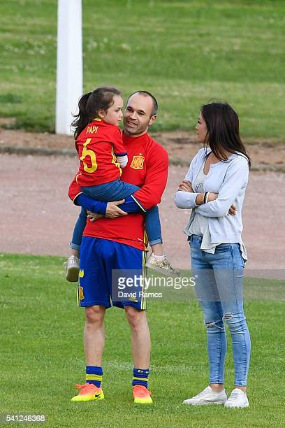Andres Iniesta of Spain shares a moment with his wife Anna Ortiz and his daughter Valeria after a training session at Complexe Sportif Marcel...