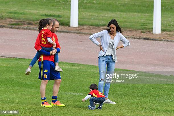 Andres Iniesta of Spain shares a moment with his wife Anna Ortiz his daughter Valeria and his son Paolo Andrea after a training session at Complexe...
