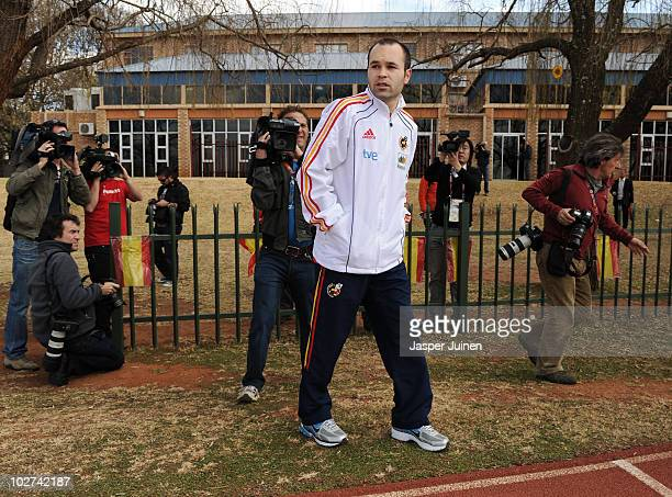 Andres Iniesta of Spain walks the hotel premises surrounded by members of the media, ahead of their World Cup 2010 Final match against the...
