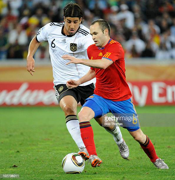 Andres Iniesta of Spain with Sami Khedira of Germany during the 2010 FIFA World Cup South Africa Semi Final match between Germany and Spain at Durban...