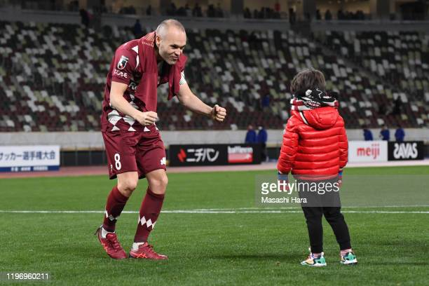 Andres Iniesta of Vissel Kobe and his son celebrate after the 99th Emperor's Cup final between Vissel Kobe and Kashima Antlers at the National...